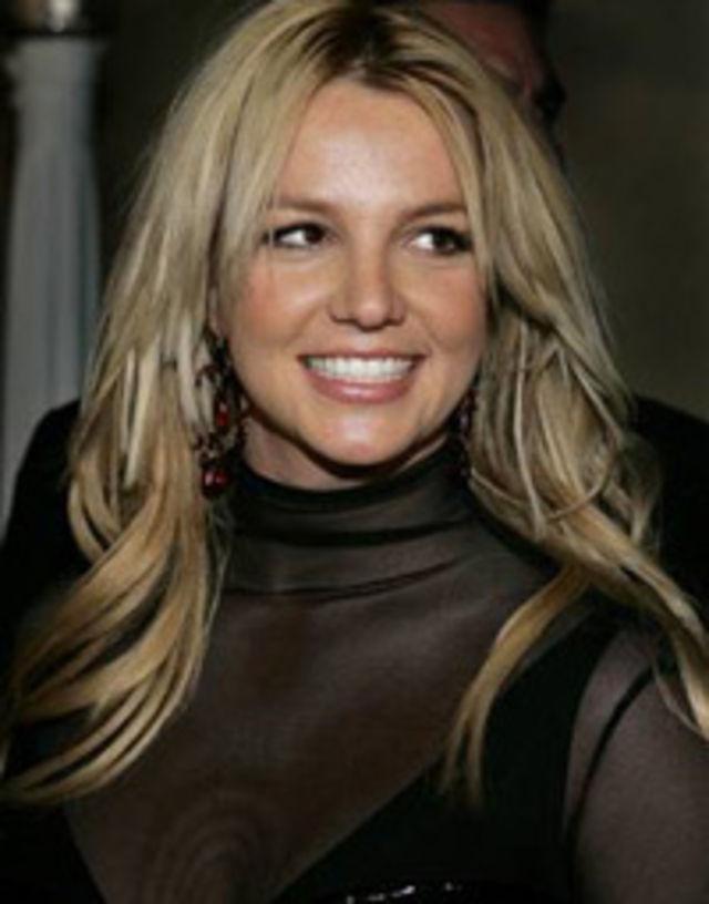 Britney Spears flashes her toned legs in boho mini dress