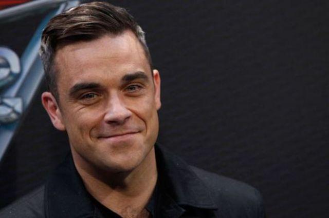 "Robbie Williams a lansat clipul piesei ""Love My Life"""